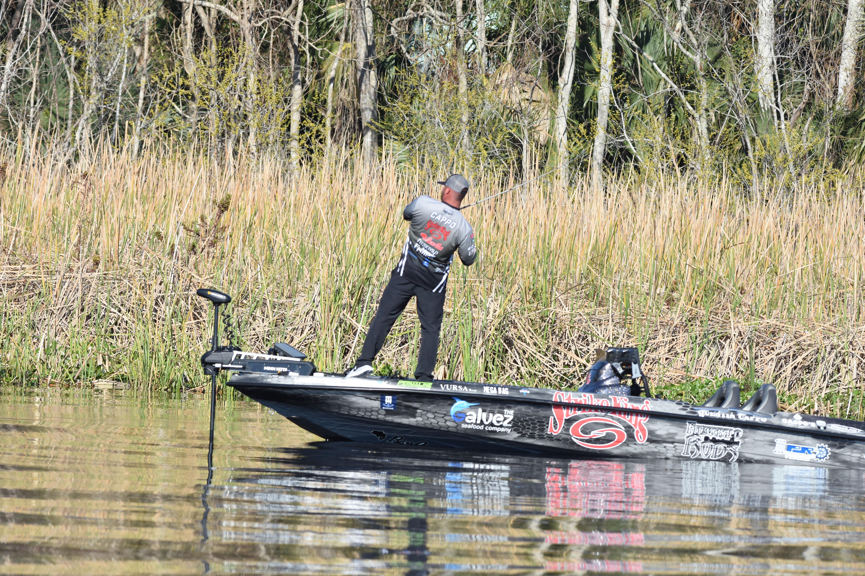 bass fisherman setting the hook